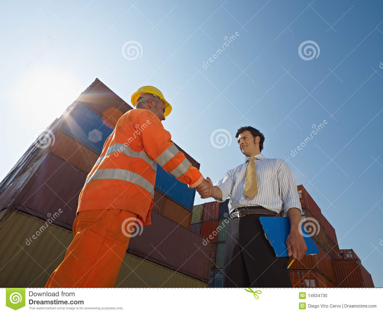 Businessman and worker with cargo containers