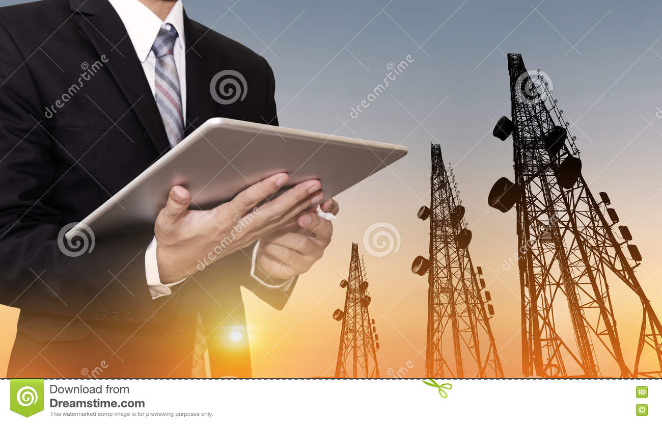 Businessman Working On Digital Tablet, With Satellite Dish
