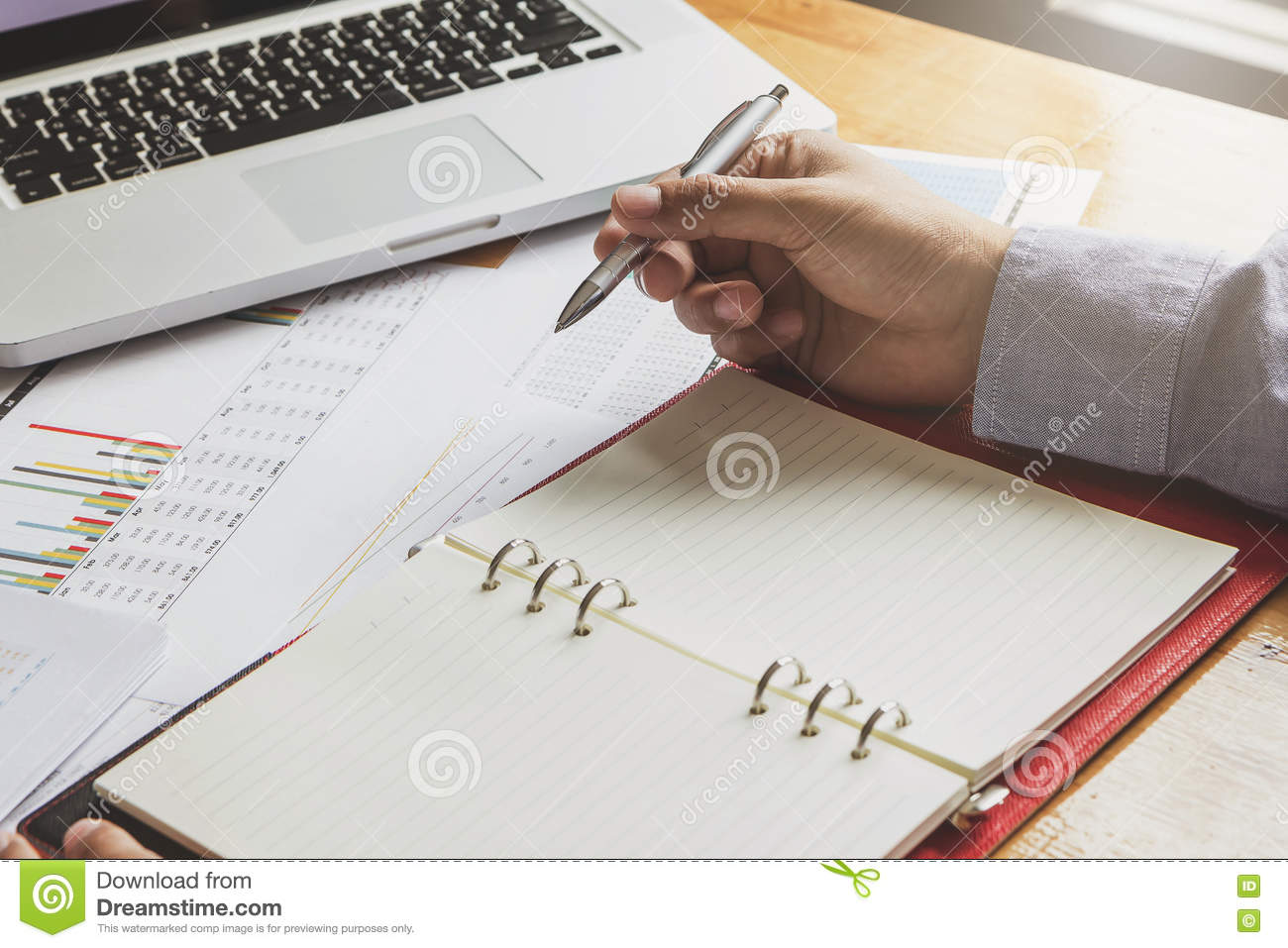 Businessman working with laptop and documents
