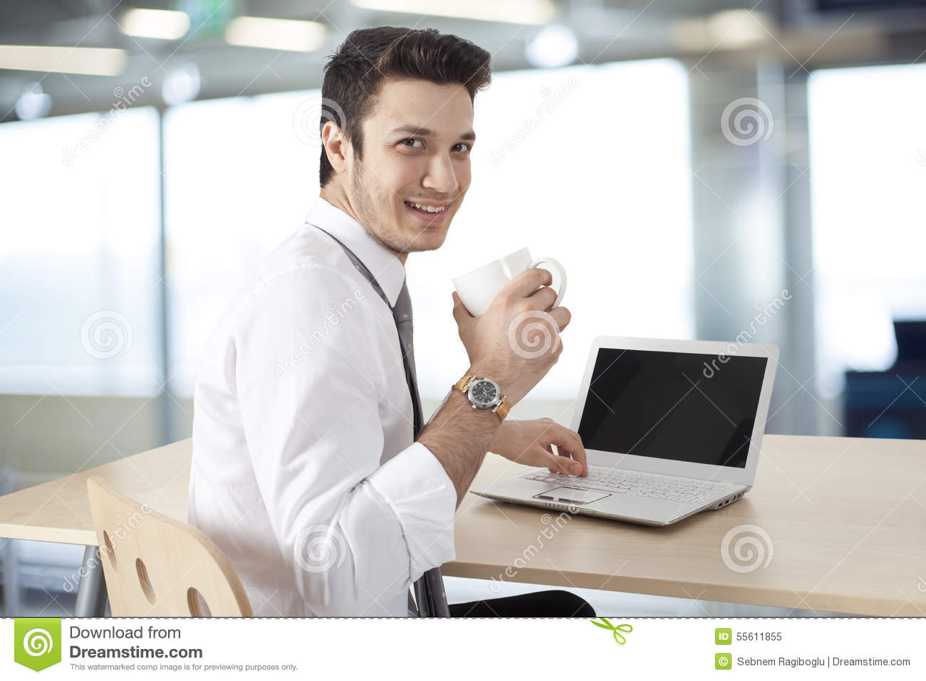 Businessman Working On Laptop And Drink Coffee Stock Photo ...