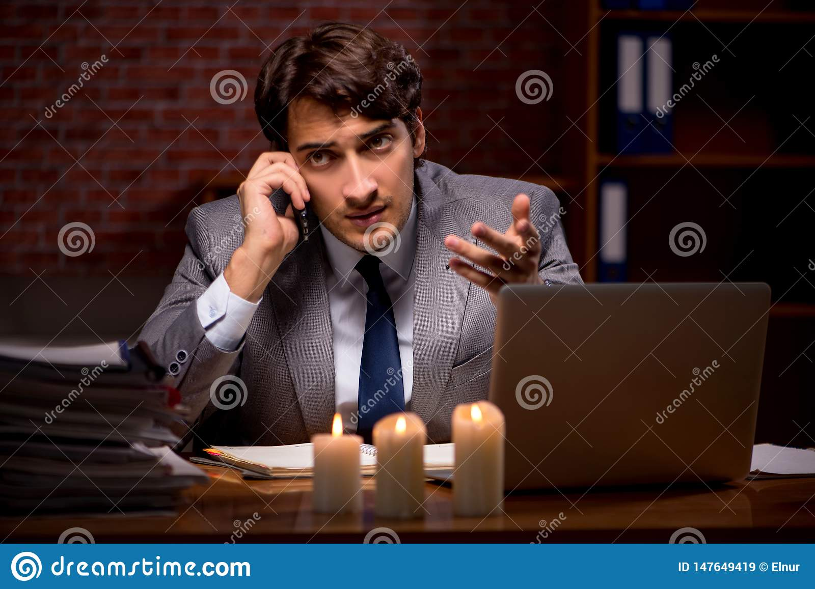 The businessman working late in office with candle light