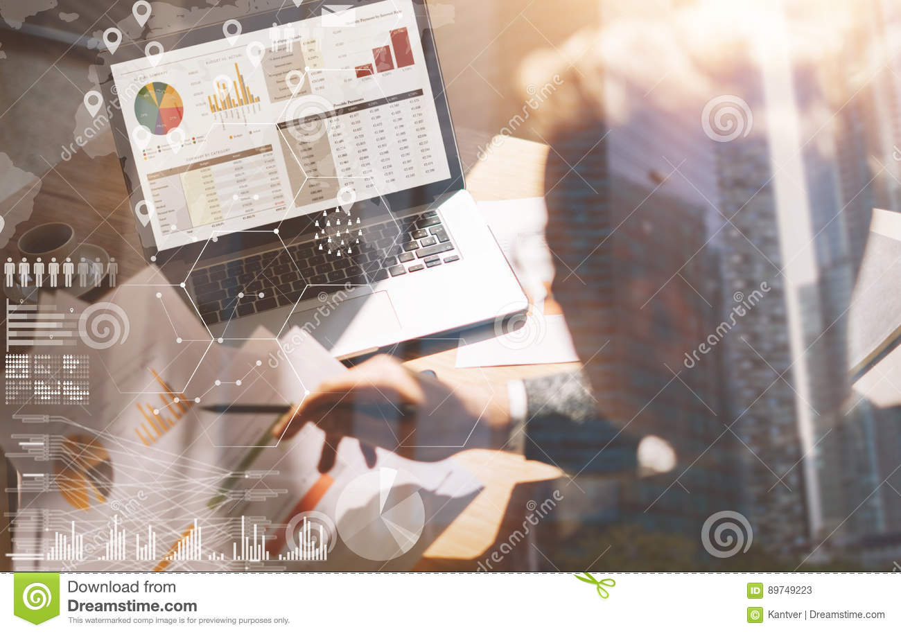 Businessman working at office on laptop.Man holding paper documents in hands.Concept of digital screen,virtual