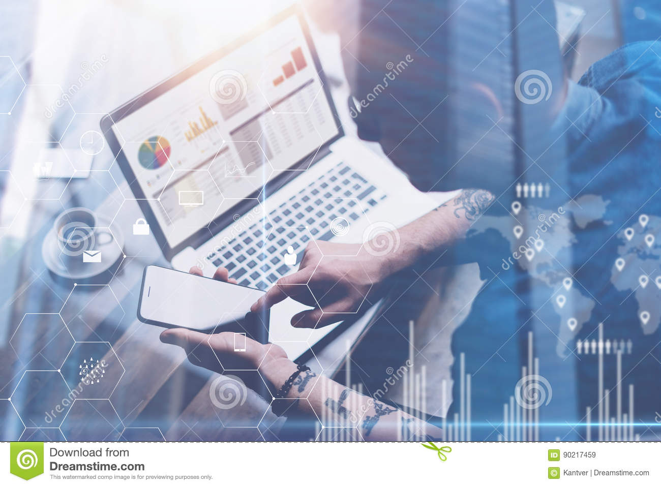 Businessman working at office on laptop.Man holding smartphone in hands.Concept of digital screen,virtual connection