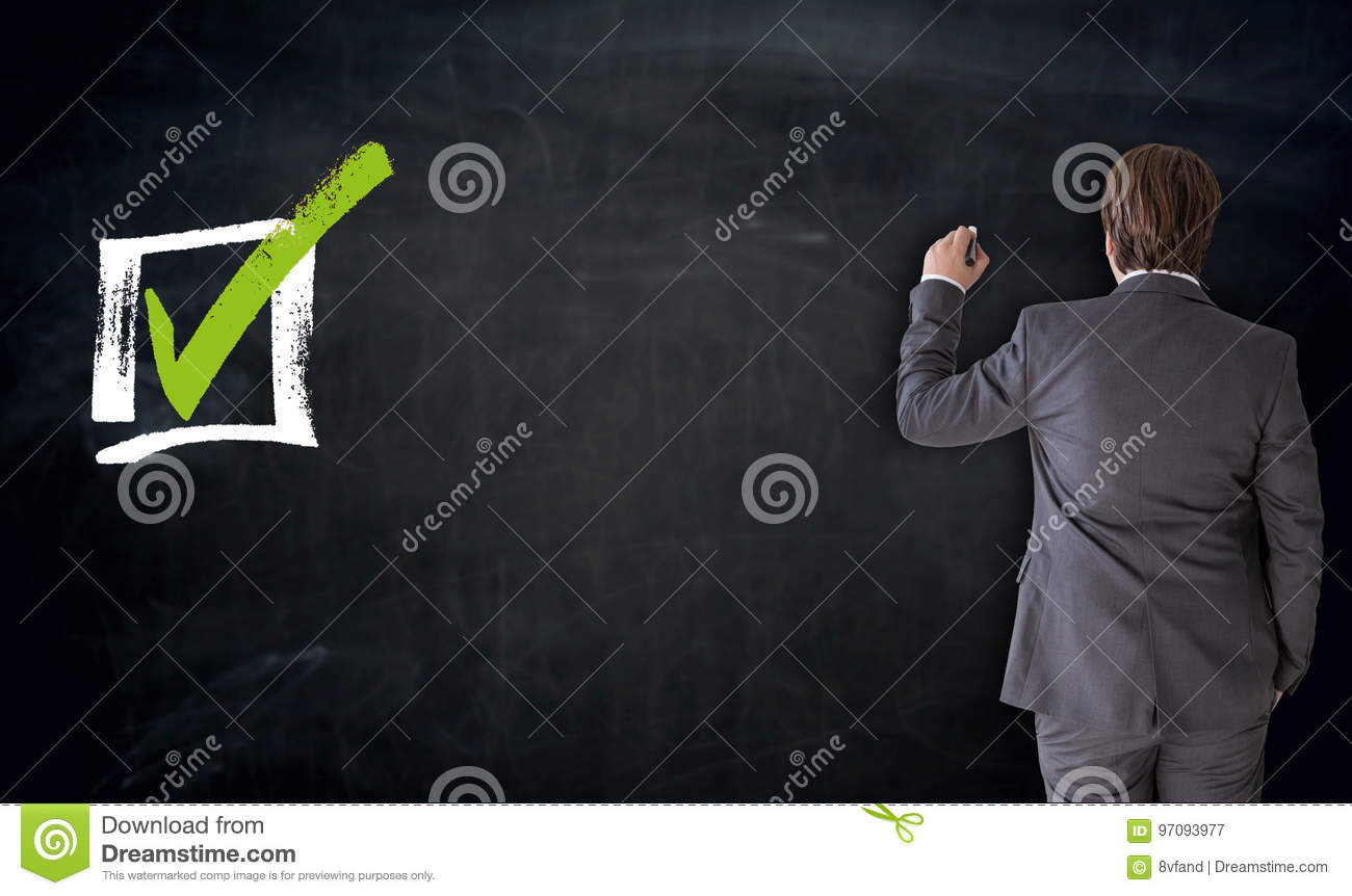 Businessman writing with checkbox concept on blackboard