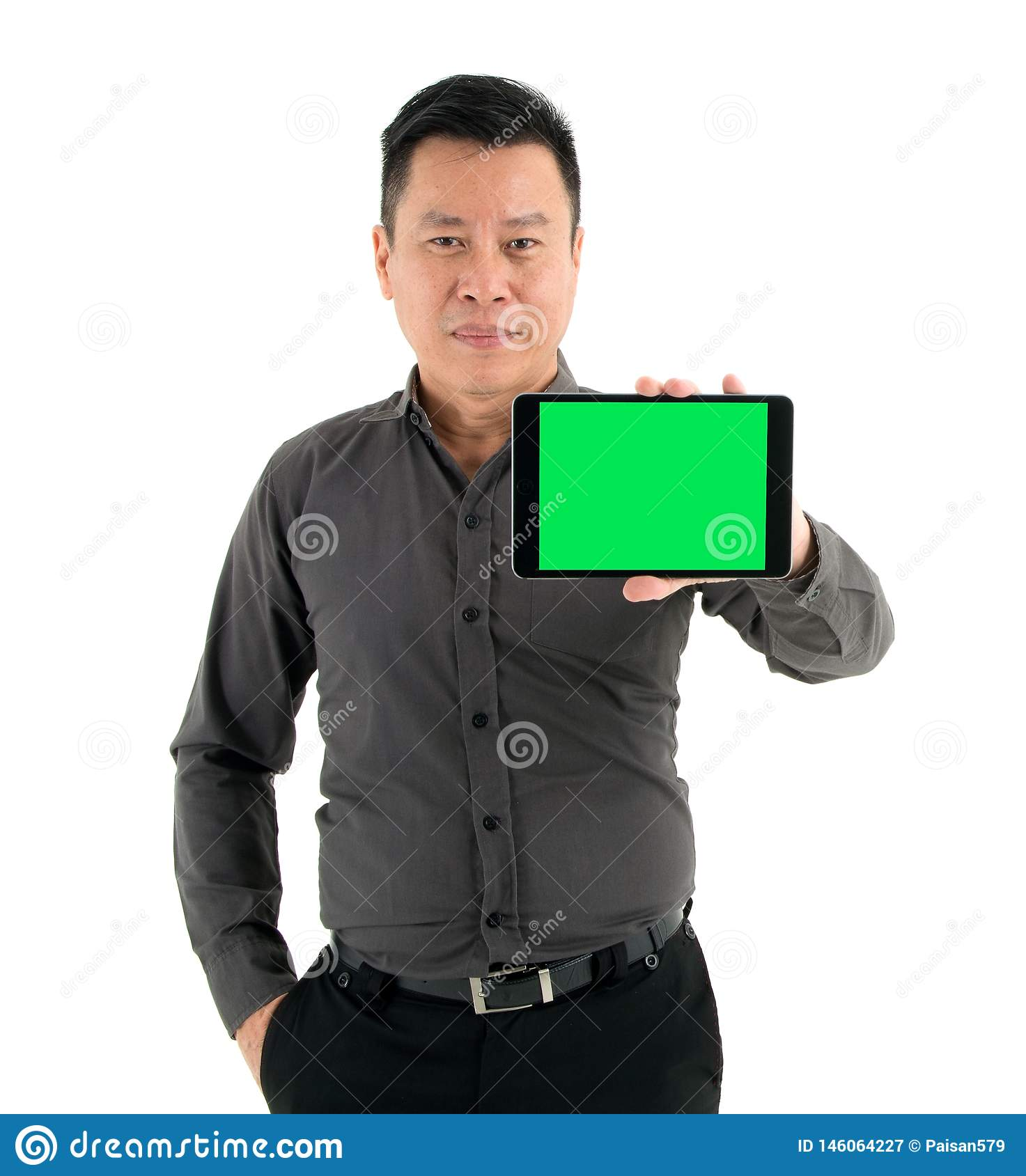 Businessmen in a brown shirt holding a tablet isolated on white background