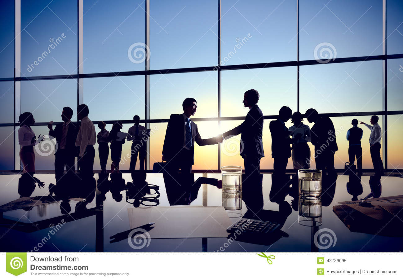 Businessmen Handshaking with Their Colleagues