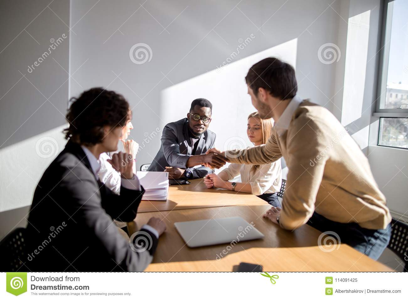 Businessmen Making Agreement Their Colleague Standing Near By Stock