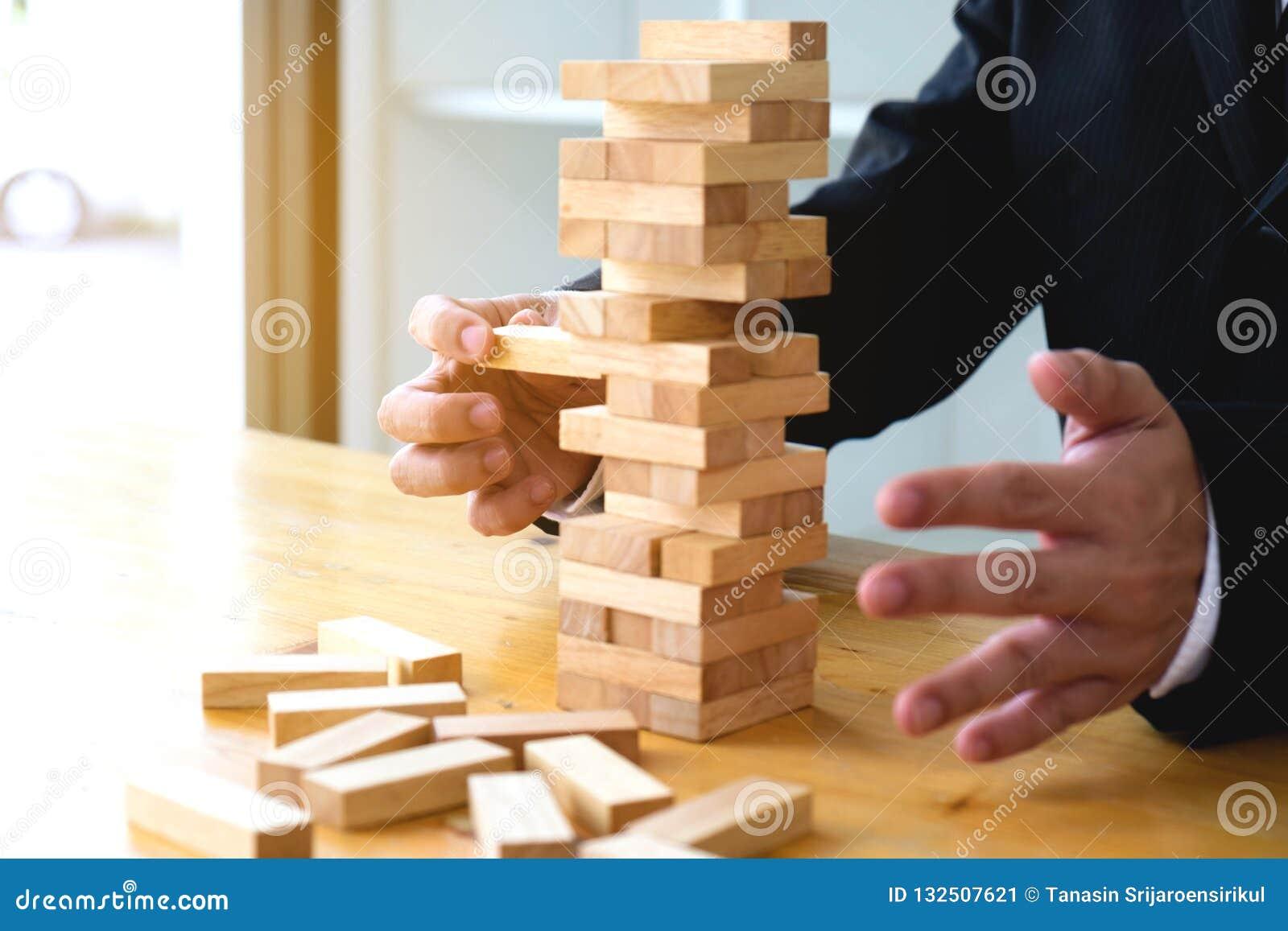 Businessmen Picking Dominoe Blocks To Fill The Missing Dominos A