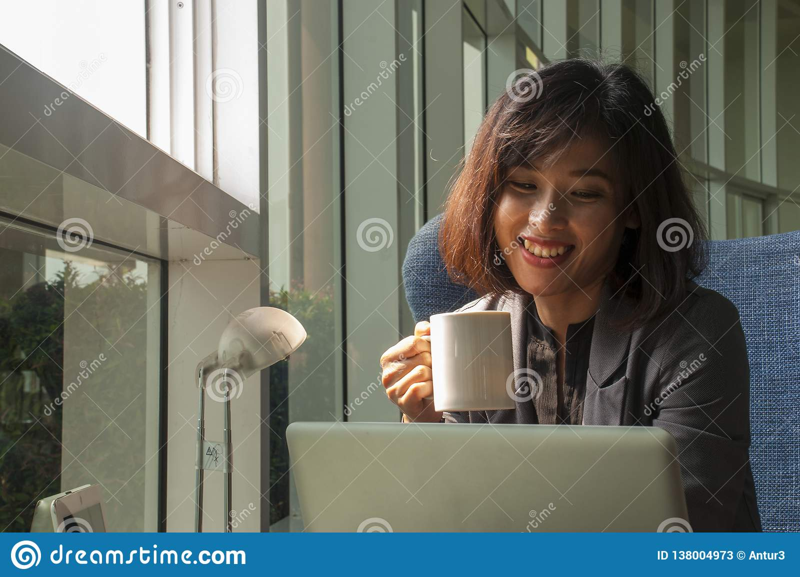 Businessmen are smiling and drinking coffee