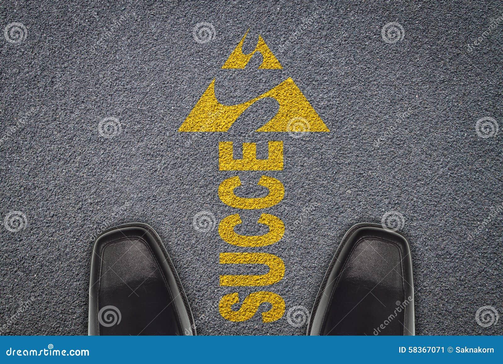 Businessmen standing in front of arrows on asphalt road,