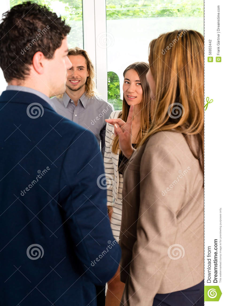 Businesspeople discussing in office