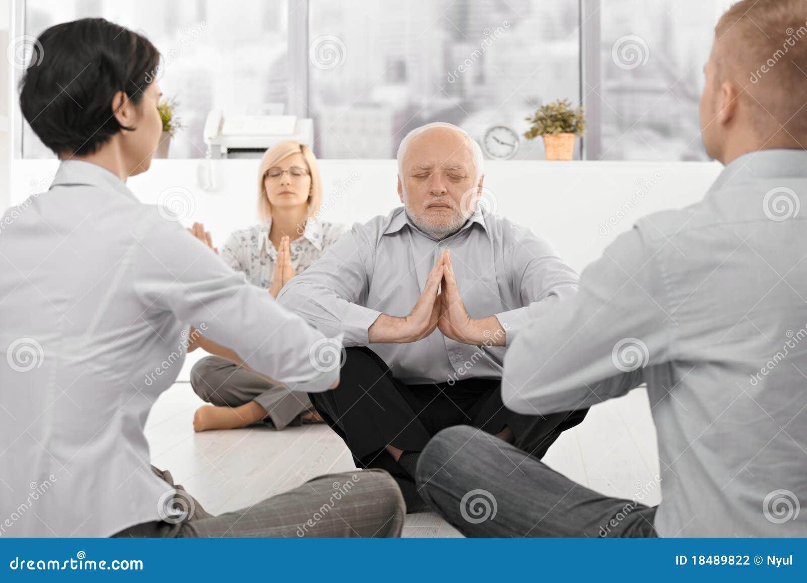 Businesspeople exercising office yoga