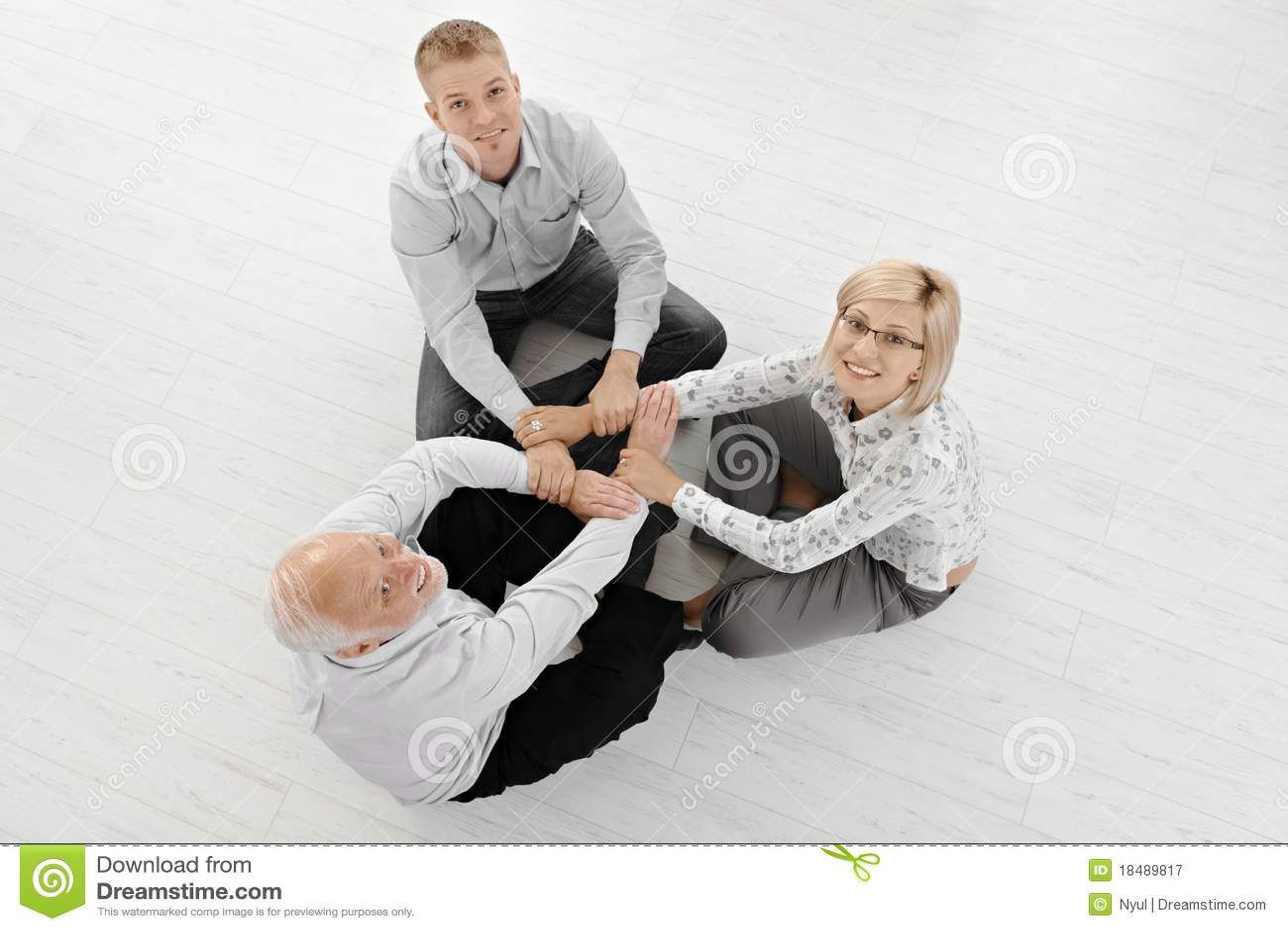 Businesspeople floor meditating three