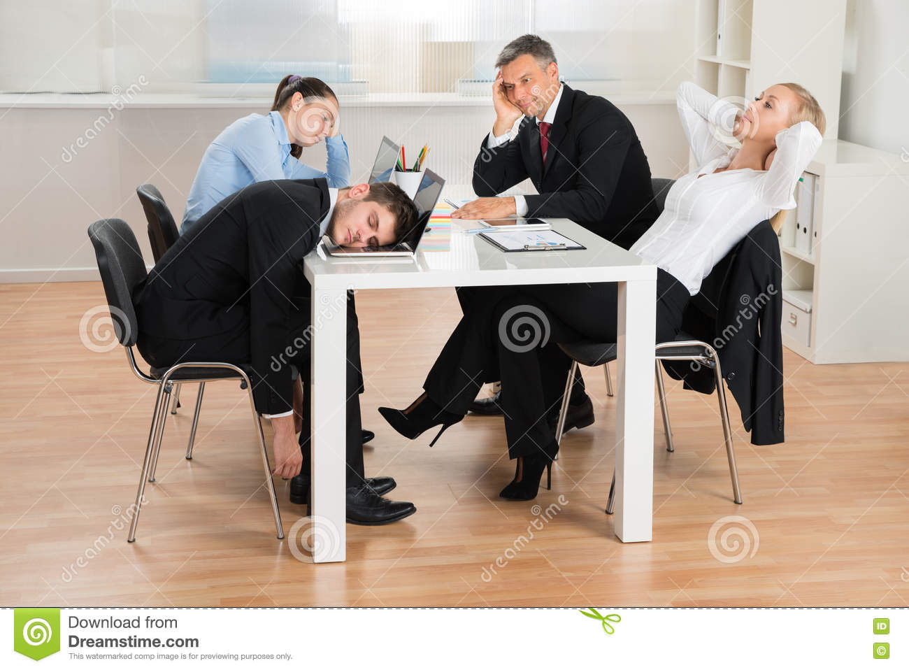Businesspeople Getting Bored In Office Stock Photo Image