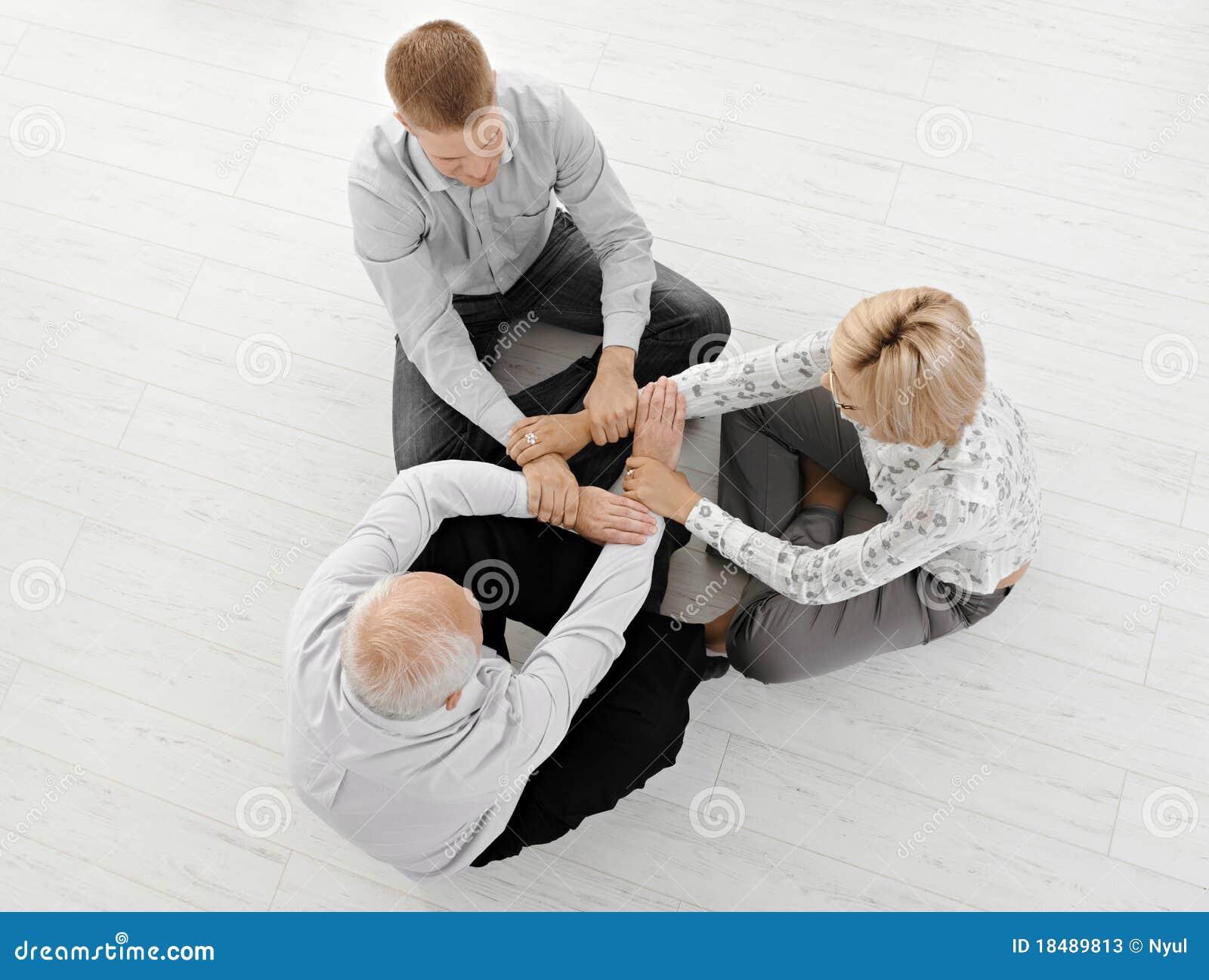 Businesspeople meditating three together