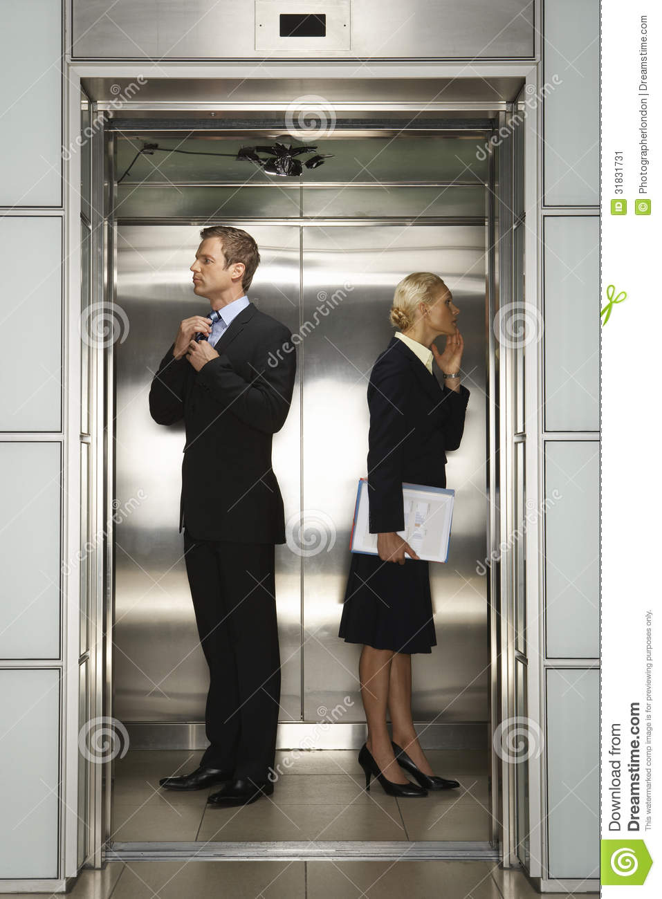 businesspeople preparing for interview in elevator stock image businesspeople preparing for interview in elevator