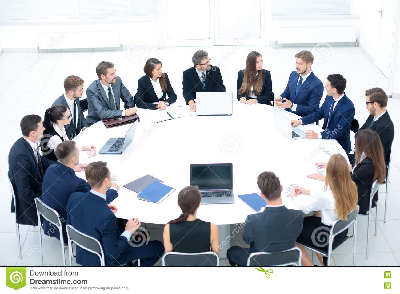 Round Table La Mesa.Businesspeople Sitting At Conference Round Table At The Meeting