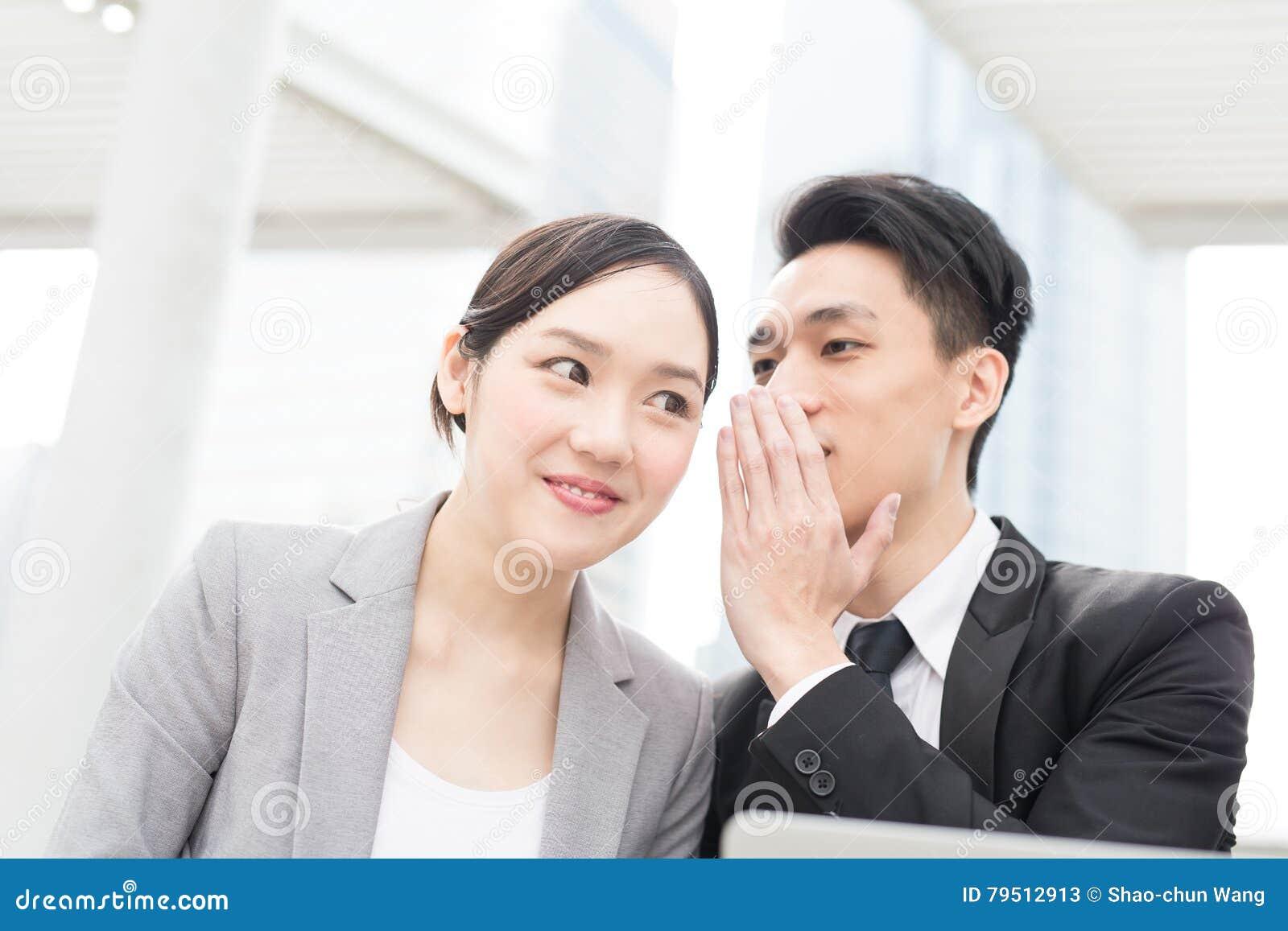 Businesspeople talk in office