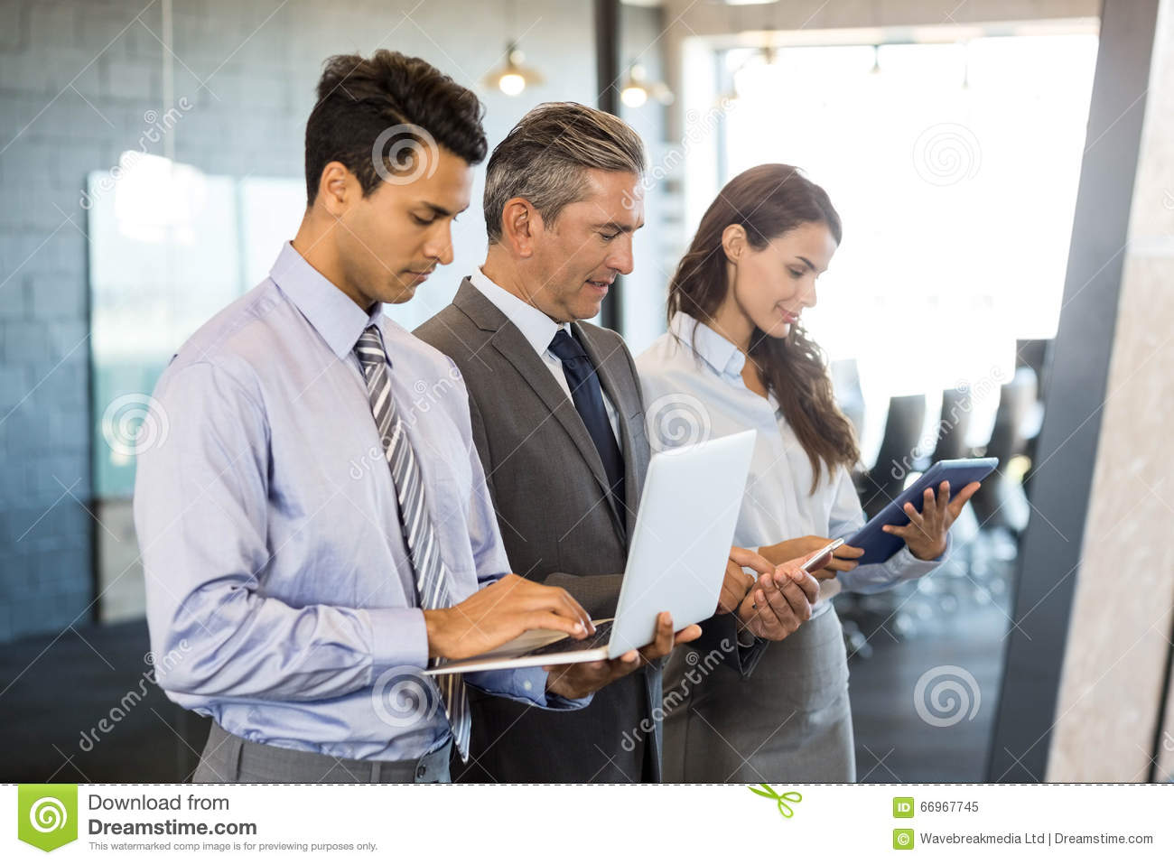 Stock Photo Businesspeople Using Mobile Phone Lap Top Digital Tablet S...