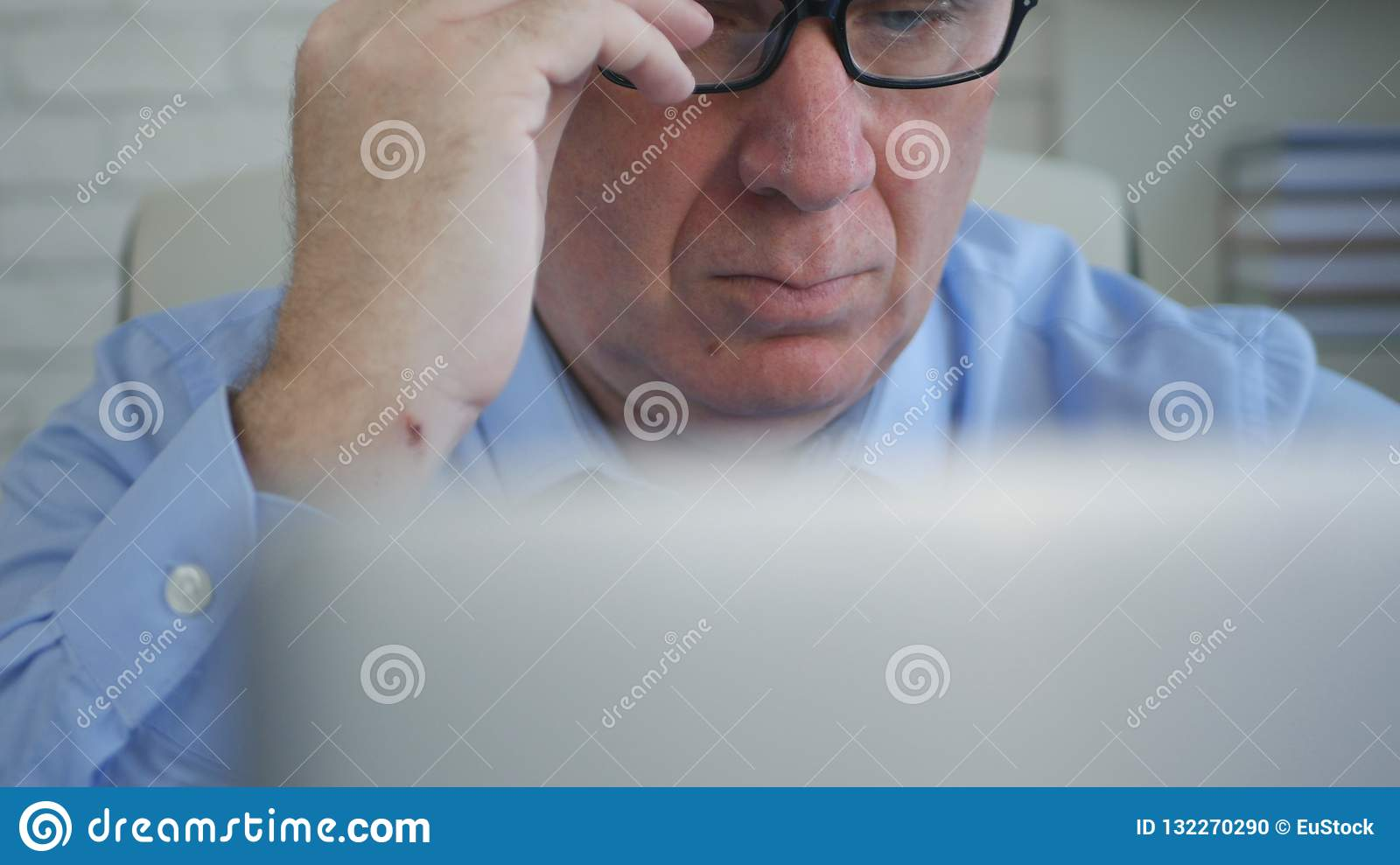 Businessperson In Office Work Using a Laptop make Financial Calculations