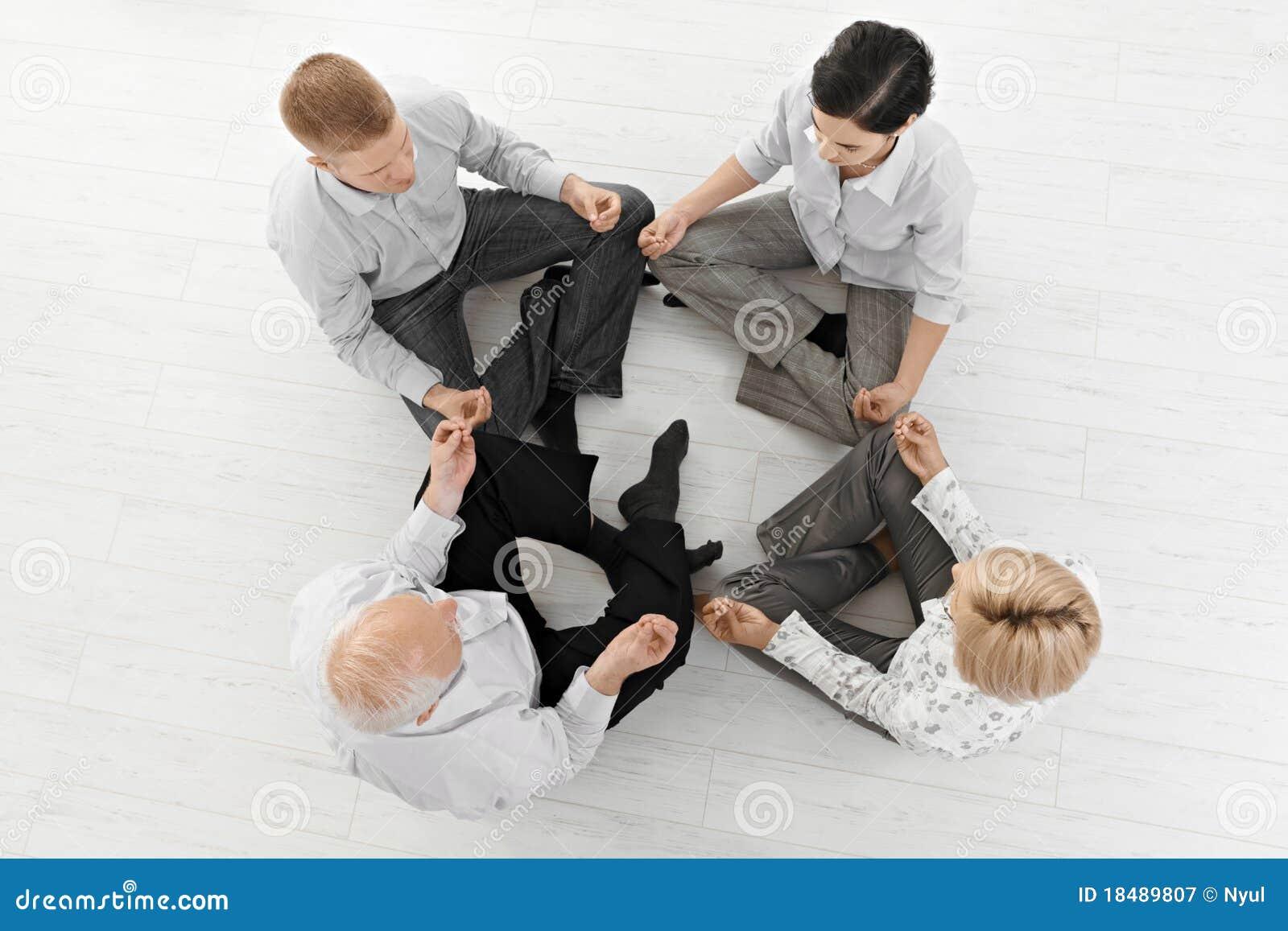 Businessteam doing meditation yoga