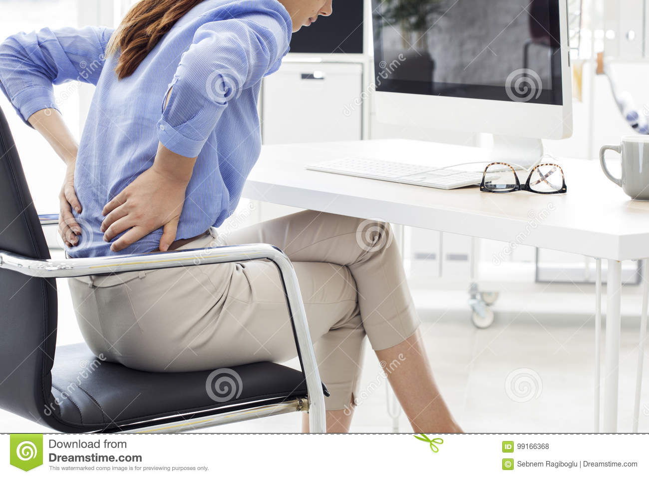 Businesswoman with back pain in office