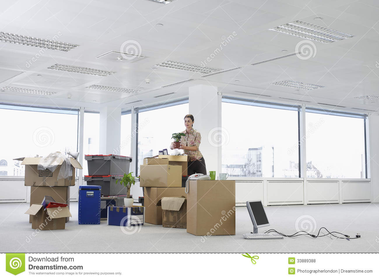 Businesswoman With Cartons Moving Into New Office Royalty Free ...