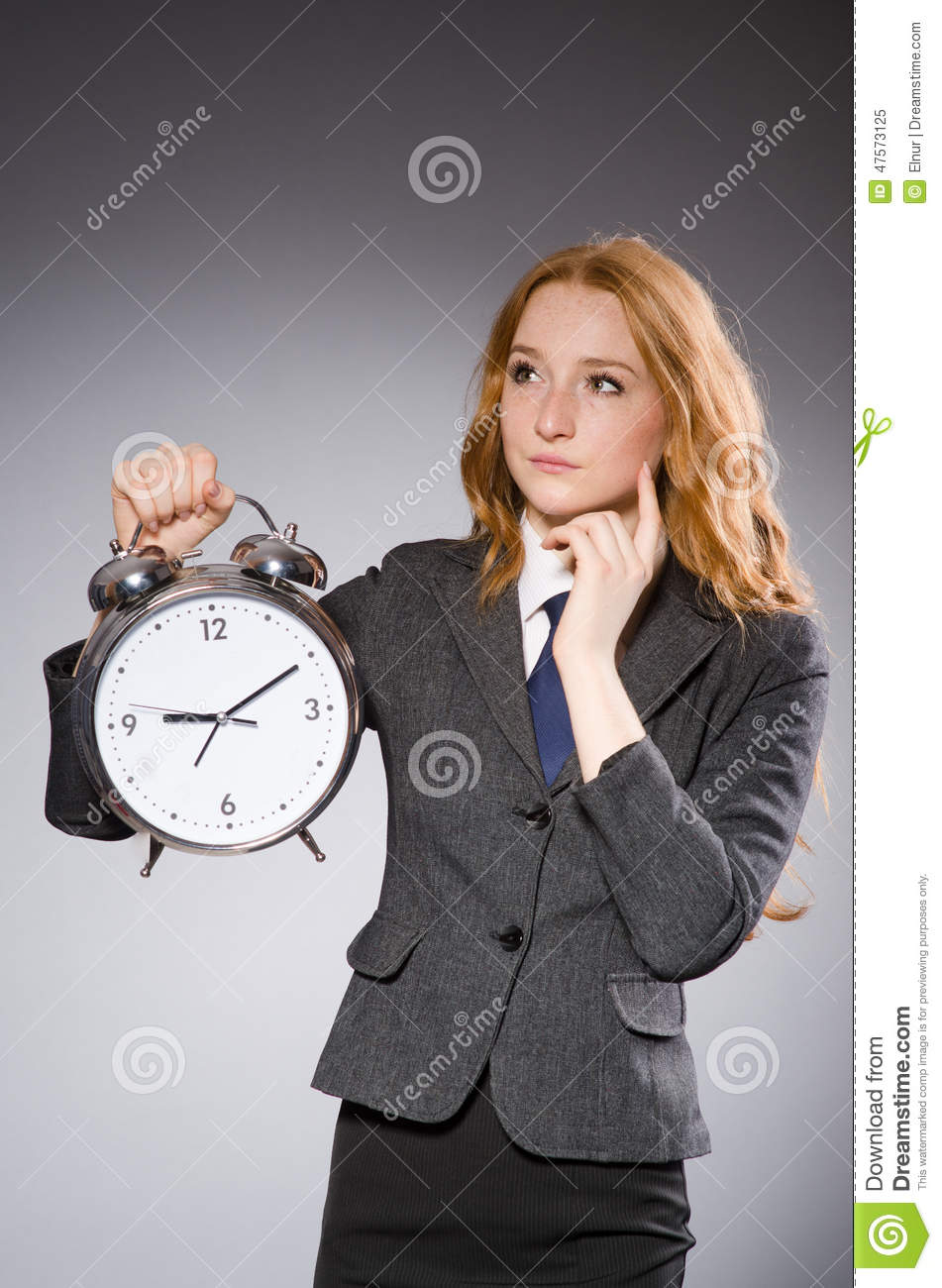 Her Late Night Cravings A Life S Checklist: Businesswoman With Clock Being Late Stock Photo