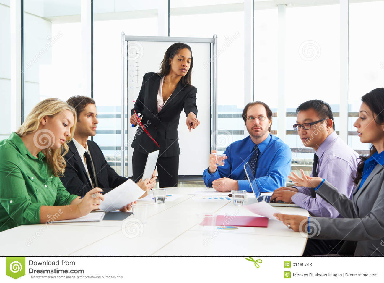 Businesswoman Conducting Meeting In Boardroom Royalty Free Stock ... Business Meeting Handshake