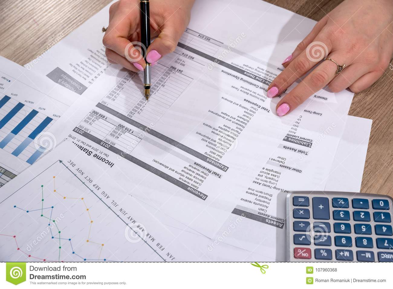 Businesswoman counting on calculator annual home budget