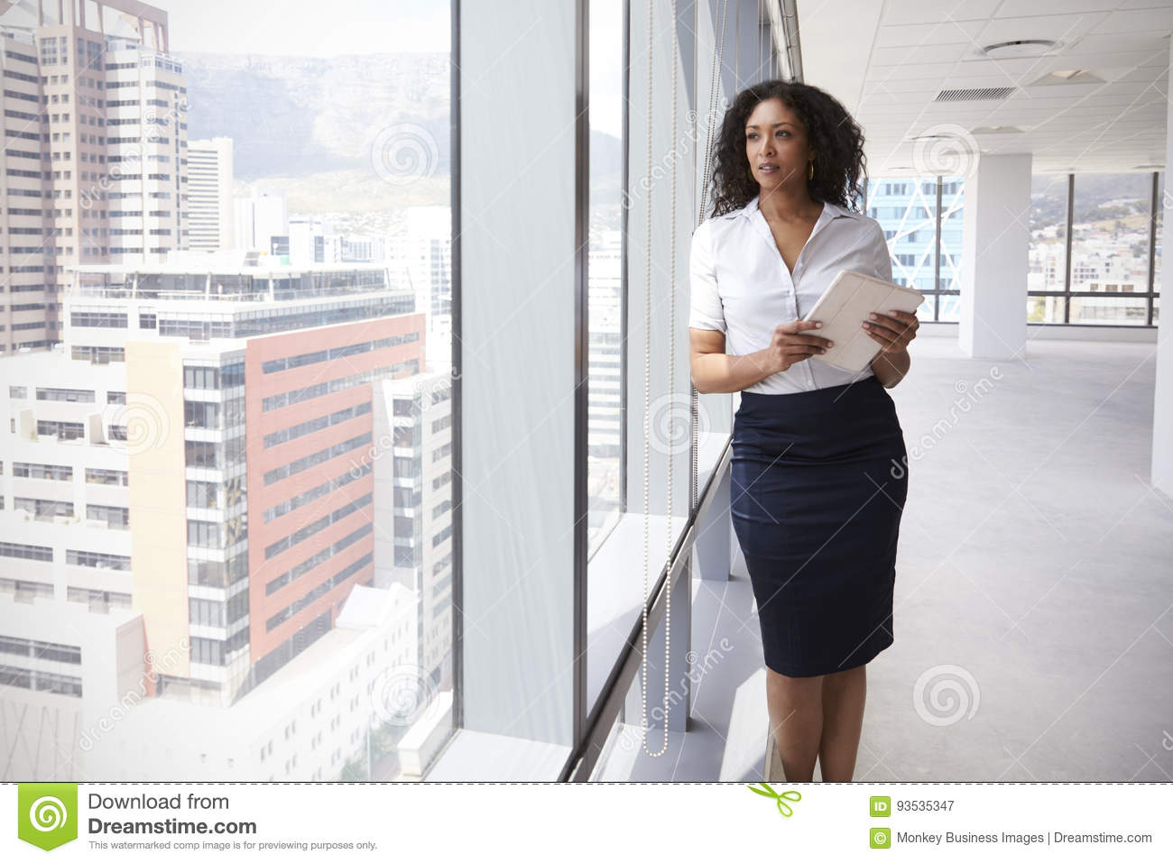 Download Businesswoman With Digital Tablet By Window Of New Office Stock Image - Image of looking, blueprints: 93535347