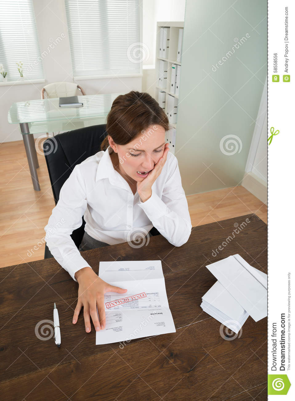 Businesswoman With Document In Office Stock Photo - Image ...