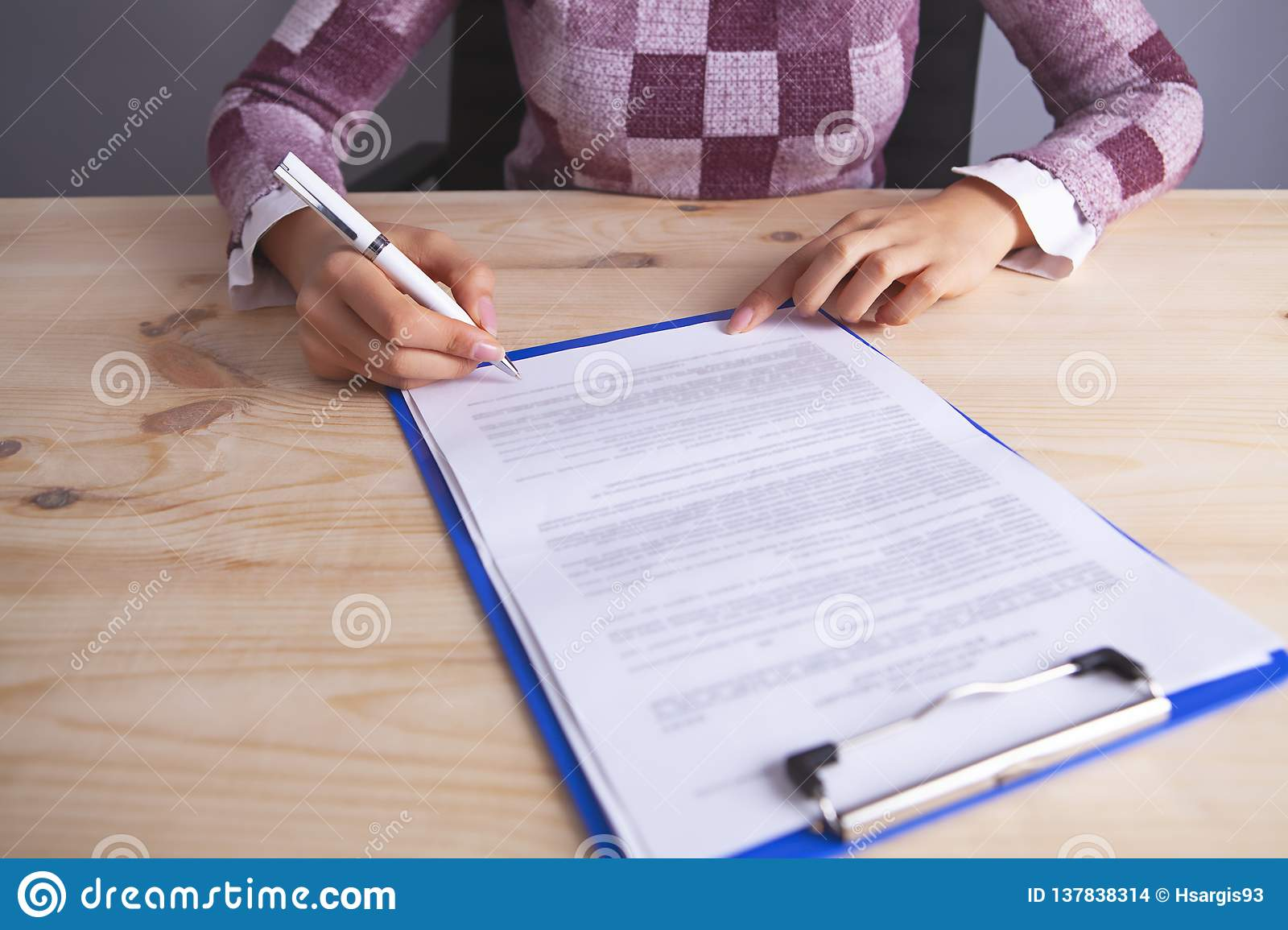 Businesswoman documents to sign