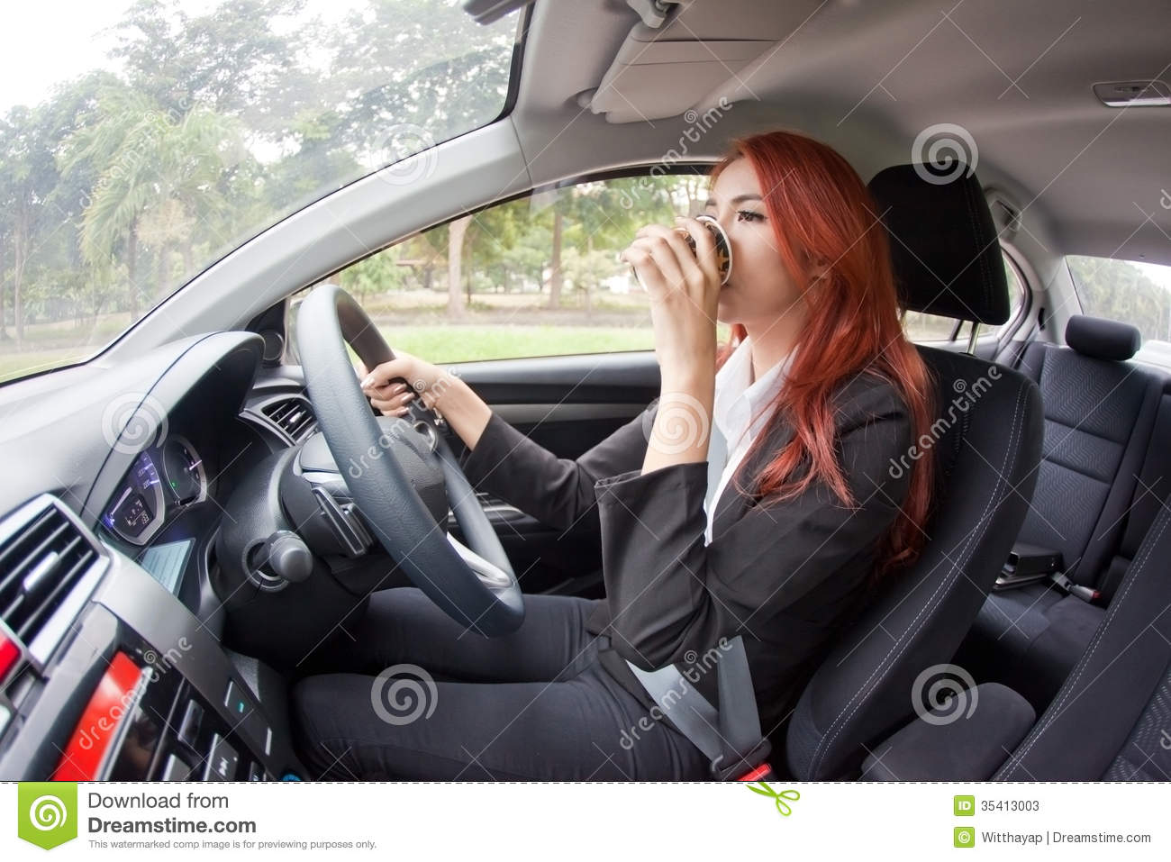 Asian lady driving that interfere