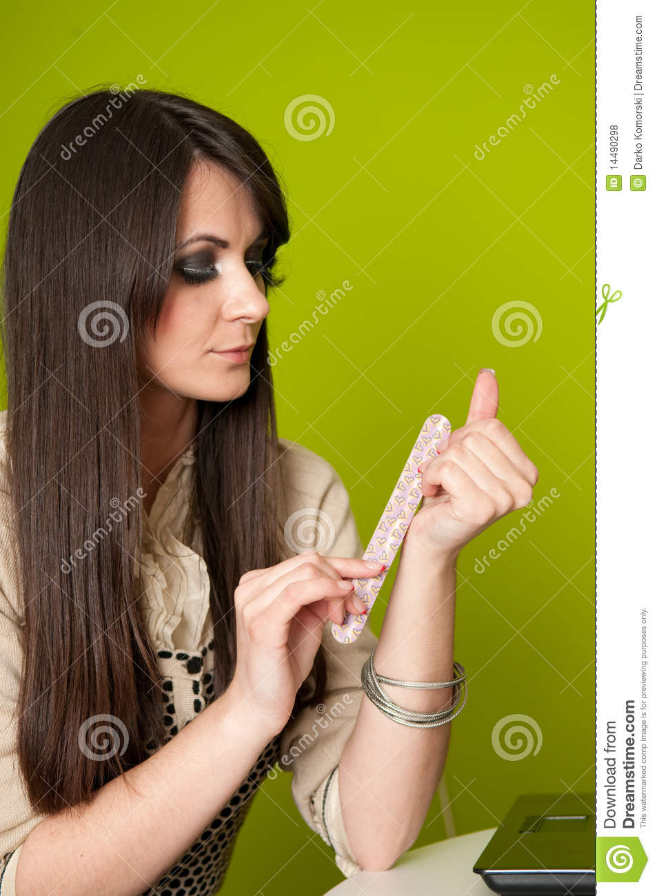 Businesswoman filing nails stock photo. Image of attractive - 14490298