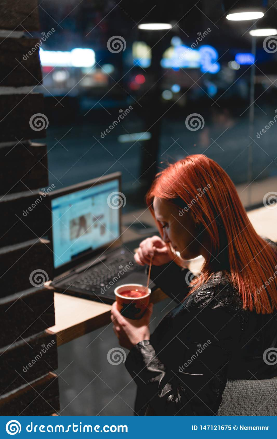 Businesswoman, girl working on laptop in cafe, smartphone, pen, use computer. Freelancer works remotely. Online marketing,