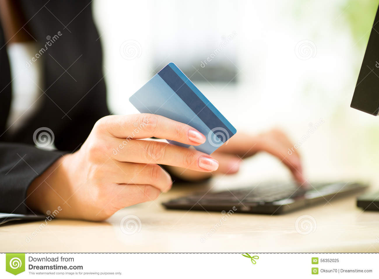 Businesswoman holding credit card on laptop for online payment concept