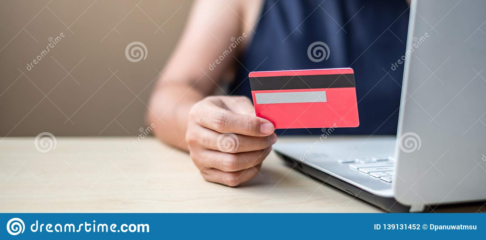 Businesswoman holding credit card for online shopping while making orders via the Internet. business, technology, ecommerce and