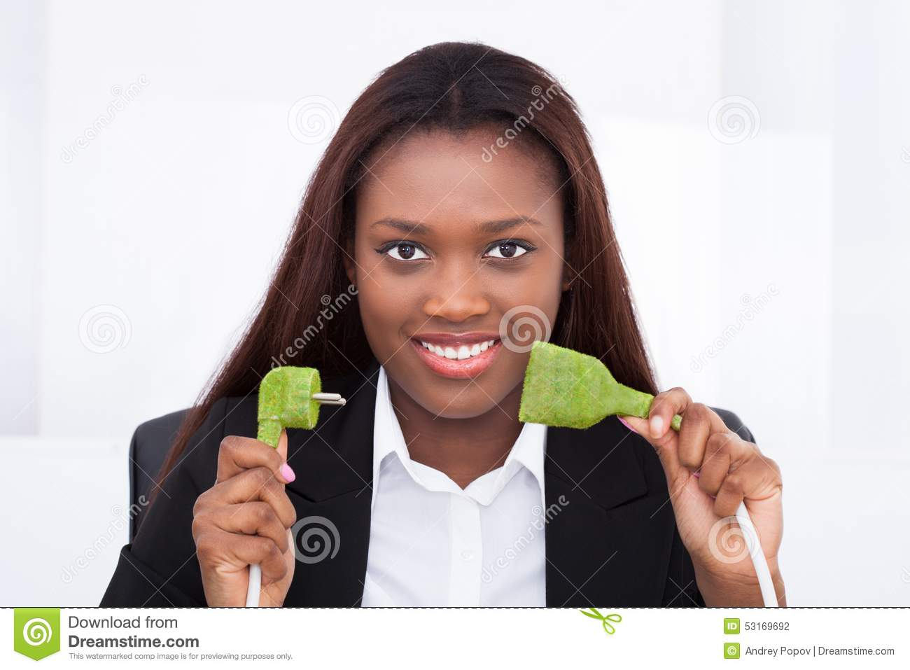 Download Businesswoman Holding Green Plug In Office Stock Photo - Image of ecology, conservation: 53169692
