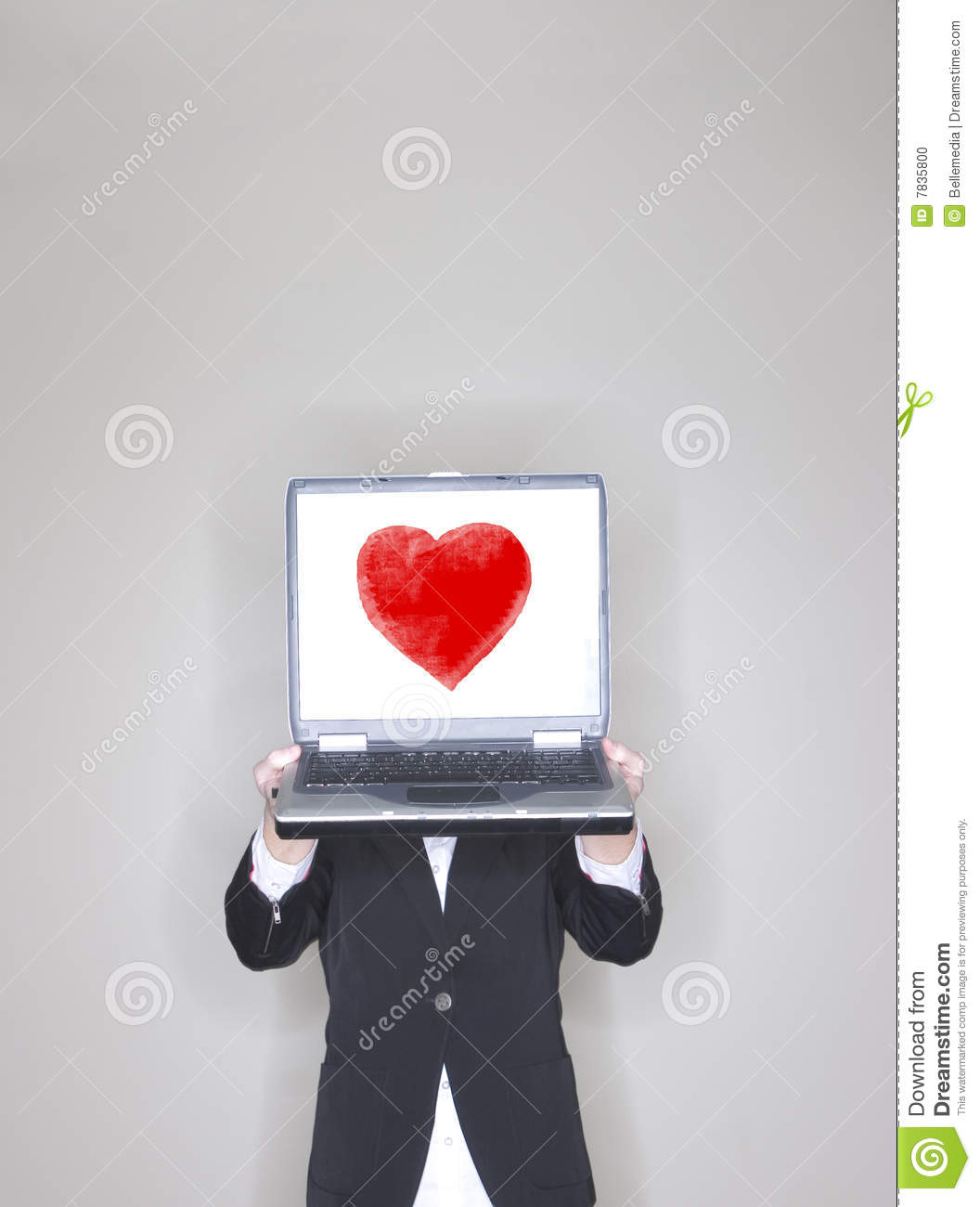 Businesswoman holding laptop with heart