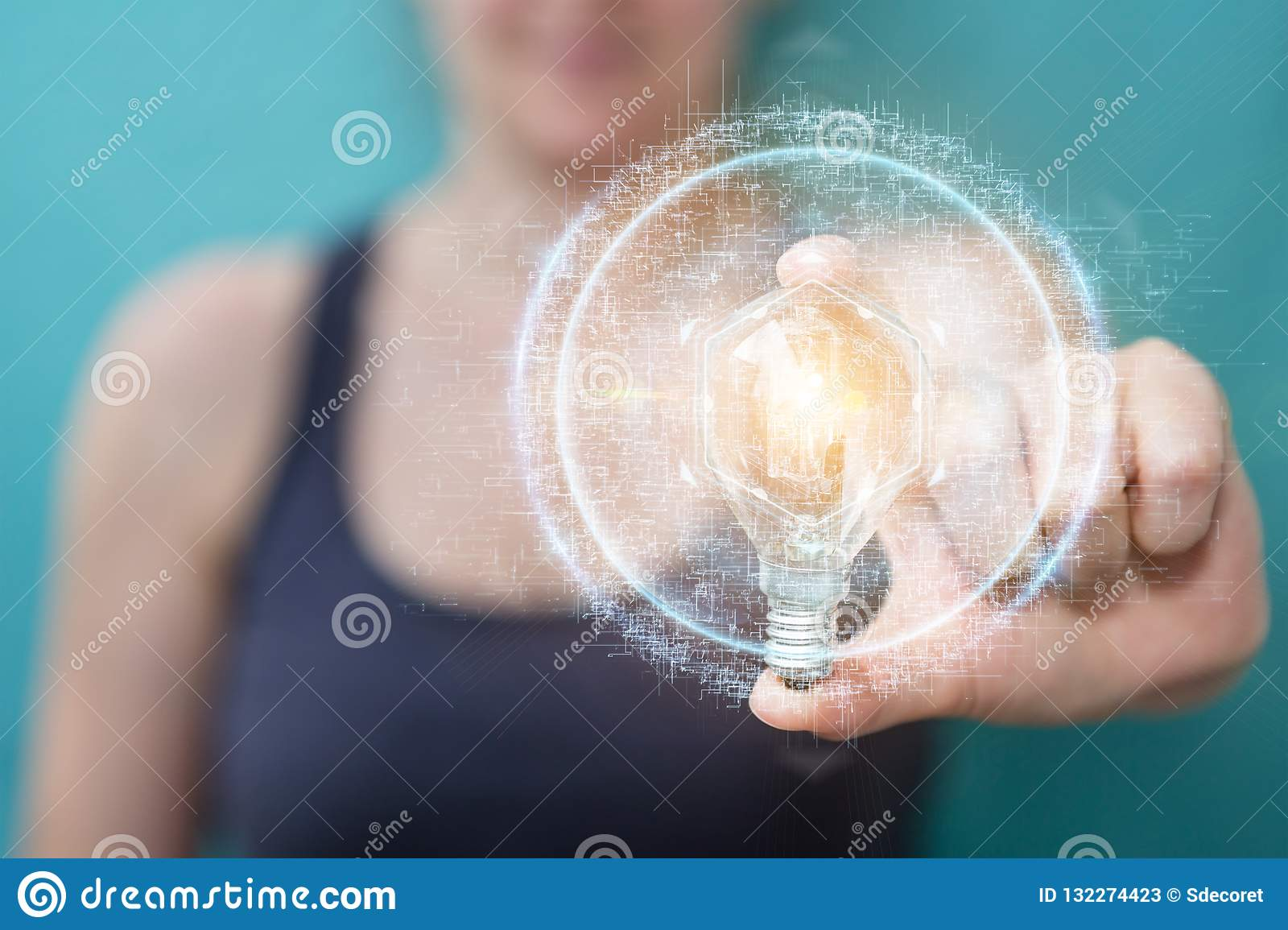 Businesswoman holding a lighbulb with connections in her hand 3D