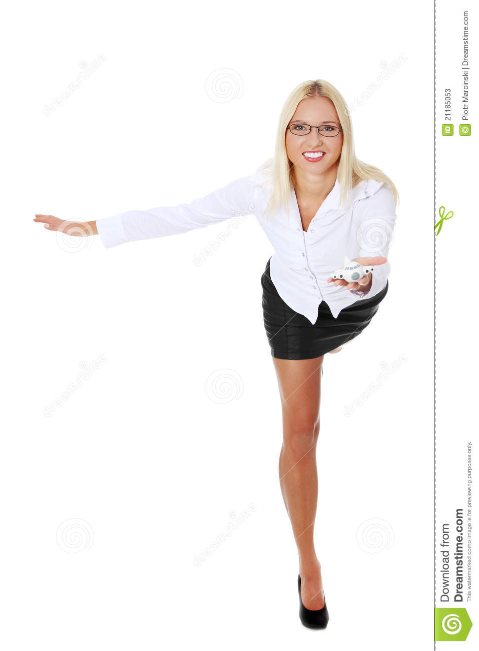 Businesswoman holding a plane toy.