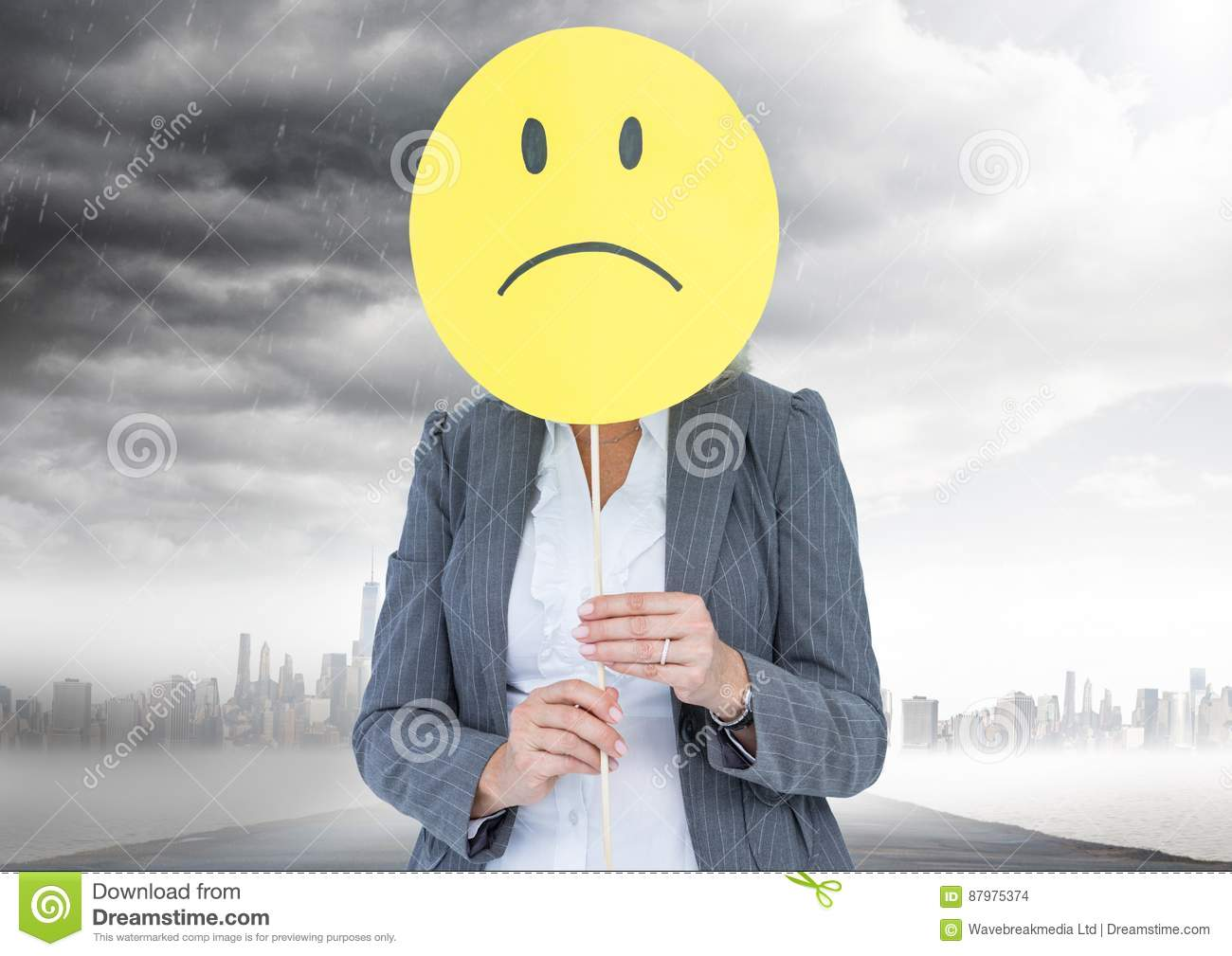 Businesswoman Holding A Smiley Face In Front Of Her Face With Rain