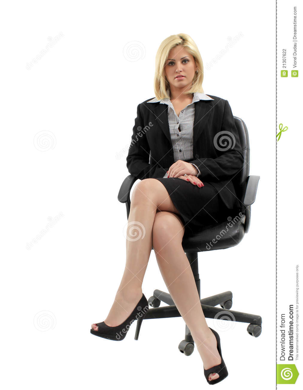 ... black suit, sitting in office chair, isolated on white studio