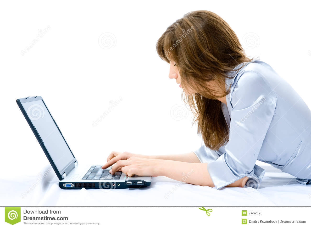 Businesswoman With Laptop Lying On The Floor Stock Photo