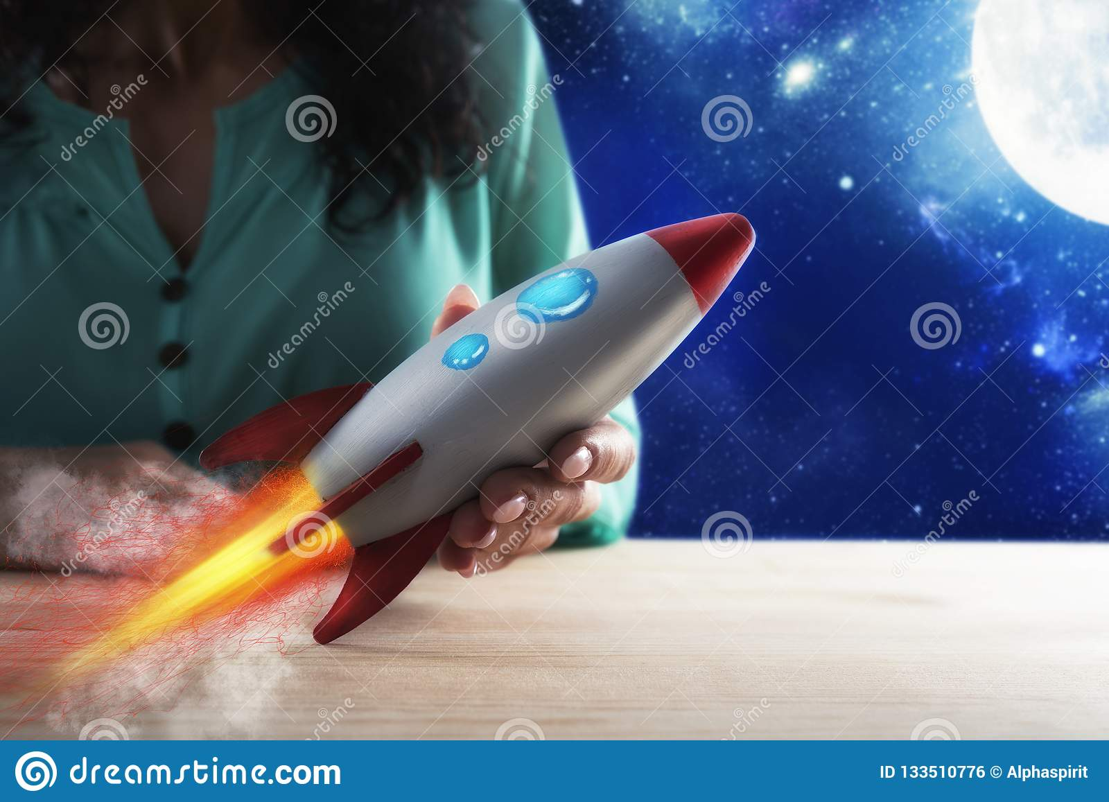 Businesswoman launches his company with a rocket. Concept of startup and innovation