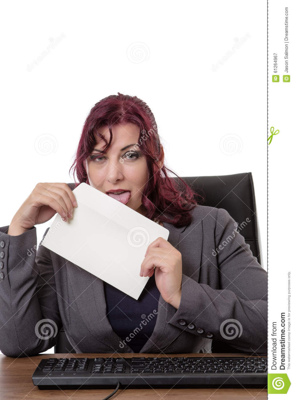 Woman Licking An Envelope Stock Photography