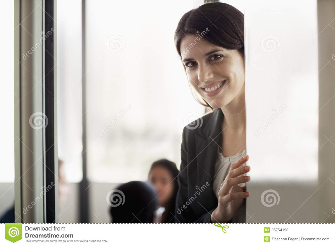 Businesswoman looking at the camera and smiling during a business meeting