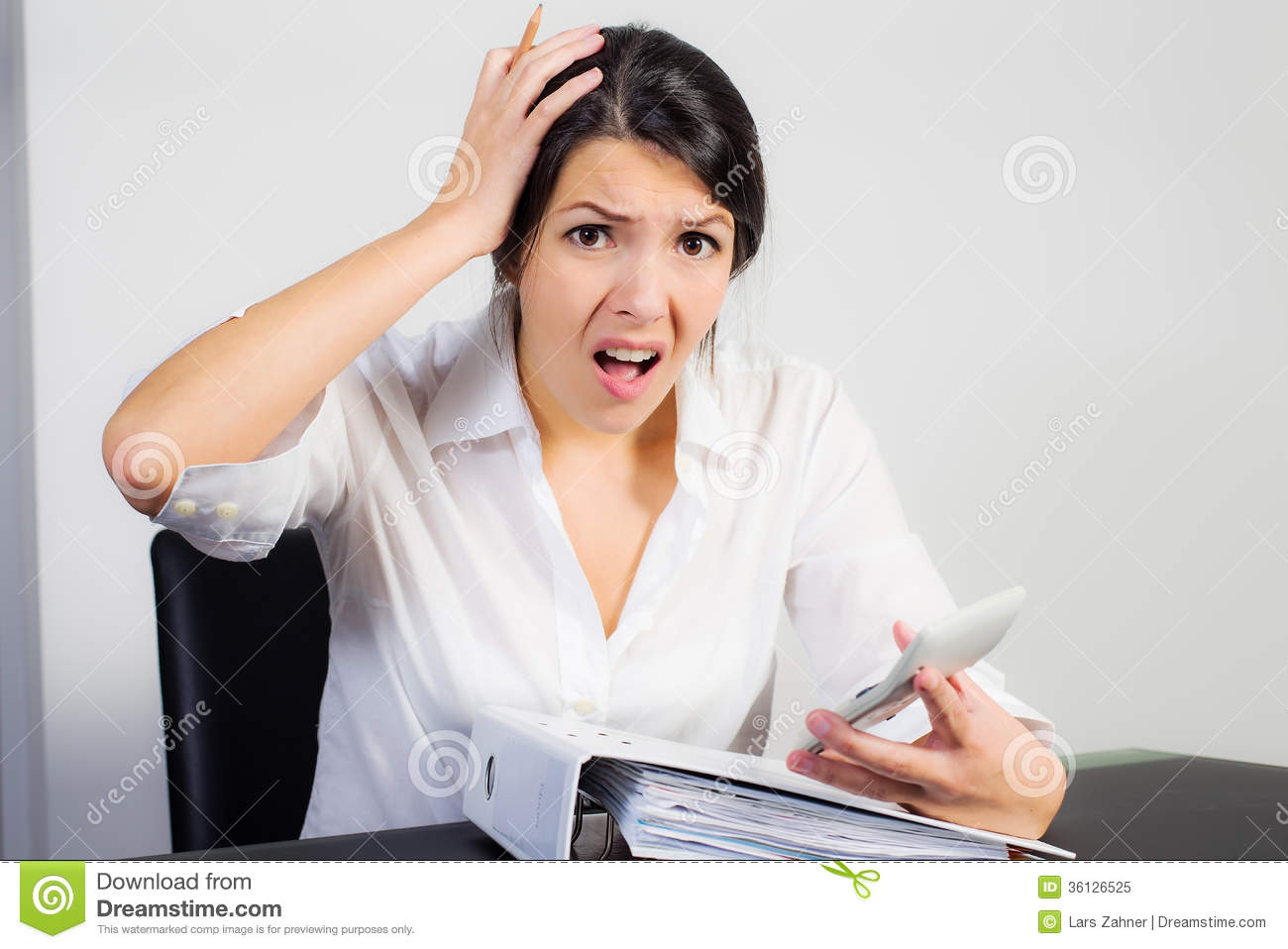 Businesswoman Looking At Her Calculator In Horror Royalty Free Stock ...