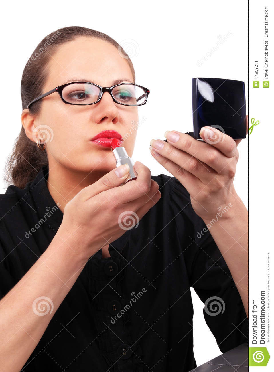 Businesswoman making make-up